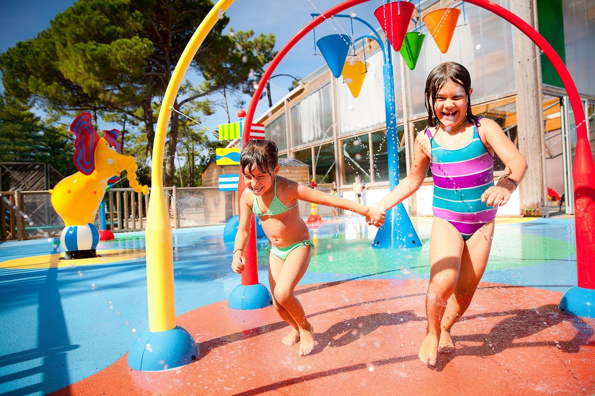 Atoll Beach pool with a Spray Park